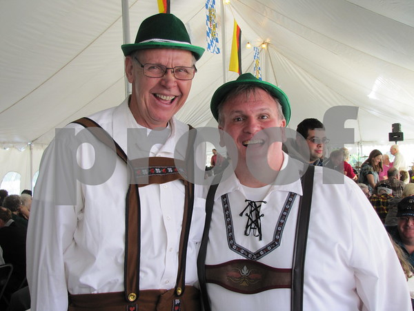 Curt Olson and Jim Reed  are all smiles as Oktoberfest gets underway at Oleson Park.