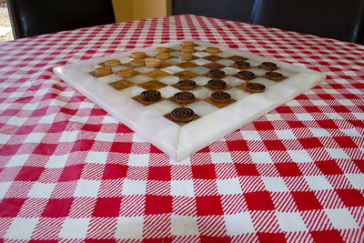 Italians love checkers. Challenge Chef Gio to a quick game of checkers while you wait 8 minutes for your pizza pie to bake.