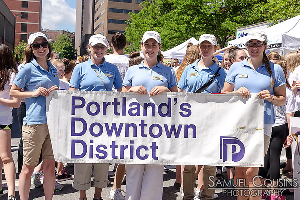Folks from the Portland Downtown District leading the Old Port Festival parade.