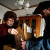 N0108FIRE330.jpg Roger Williams and his wife Gwen pack photo albums as the fire nears Lake Valley Golf Course in north Boulder on Wednesday, January 7, 2008.<br /> CAMERA / KASIA BROUSSALIAN