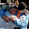 N0110GOLD209.JPG N0110GOLD209.JPG Bobra Goldsmith, left, is hugged by friend Kris Paige, after returning to her home on Thursday.<br /> Llama Rancher, Bobra Goldsmith, lost her home to one of the wind generated fires.  No people or llamas were injured at the ranch at 7202 45th Street.<br /> Cliff Grassmick/ January 8, 2009