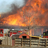 FIRES360.JPG FIRES360.JPG Firefighters can only watch as a house north of Boulder Colo. burns after a wind-blown grass fire moved past on Wednesday January 7, 2009. Small grass fires caused home evacuations and closures of roads in the area between Lyons, Colo and Boulder, Colo.<br /> Photo by Paul Aiken / The Camera / Boulder Colorado