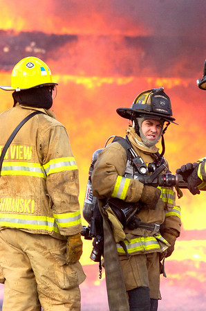 OLDESTAGE1316.JPG Firefighters can only watch as Bobra Goldsmith's house burns after a wind-blown grass fire moved past on Wednesday January 7, 2009. Small grass fires caused home evacuations and closures of roads in the area between Lyons, Colo and Boulder, Colo.<br /> PAUL AIKEN