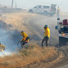 FIRES362.JPG Firefighters catch small grass fires that have jumped North Foothills Highway closing the road between Lyons north of Boulder Colo. on Wednesday January 7, 2009. Small grass fires caused home evacuations and closures of roads in the area between Lyons, Colo and Boulder, Colo.<br /> Photo by Paul Aiken / The Camera / Boulder Colorado