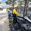 FIRE2.JPG FIRE2.jpg works on hotspots near Olde Stage Road in Boulder Thursday afternoon. <br /> Photo by Marty Caivano / January 8, 2008