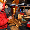 N0109FIRE30.JPG N0109FIRE30<br /> Vladimir and Eva Nejezchleb, who were among the last of the Olde Stage Road Fire evacuees, unpack their car as they return to their home on Olde Stage on Thursday night. The road was closed most of the day as fire crews finished mopping up hot spots in the area; it was reopened to residents at 6:30 p.m.<br /> cq all<br /> Photo by Marty Caivano / January 8, 2008