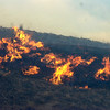 FIRES363.JPG Firefighters can only watch as a house north of Boulder Colo. burns after a wind-blown grass fire moved past on Wednesday January 7, 2009. Small grass fires caused home evacuations and closures of roads in the area between Lyons, Colo and Boulder, Colo.<br /> Photo by Paul Aiken / The Camera / Boulder Colorado