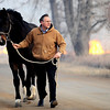 FIREML4.JPG Richard Pyle leads a horse out of the fire area along Nimbus near 35th to get away from the fire north of Boulder, Colorado January 07, 2009. The horse isn't his, he just wanted to help. CAMERA/Mark Leffingwell
