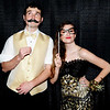 Photo courtesy of Randy Amick | TriState Studios<br /> Tyler Wachsmann (left) and Carly Wagers use props to embellish their black-and-gold prom attire.