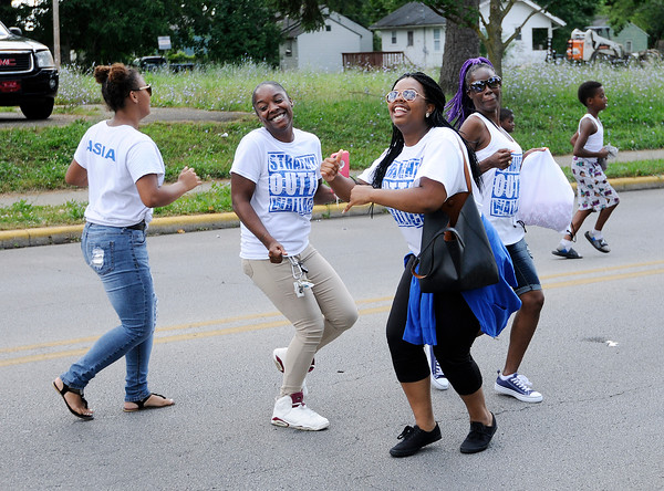 Don Knight | The Herald Bulletin Youth from Wallace Temple AME Zion Church dance as they walk in the Ollie Dixon Back-to-School parade on Saturday.