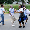 Don Knight | The Herald Bulletin<br /> Youth from Wallace Temple AME Zion Church dance as they walk in the Ollie Dixon Back-to-School parade on Saturday.
