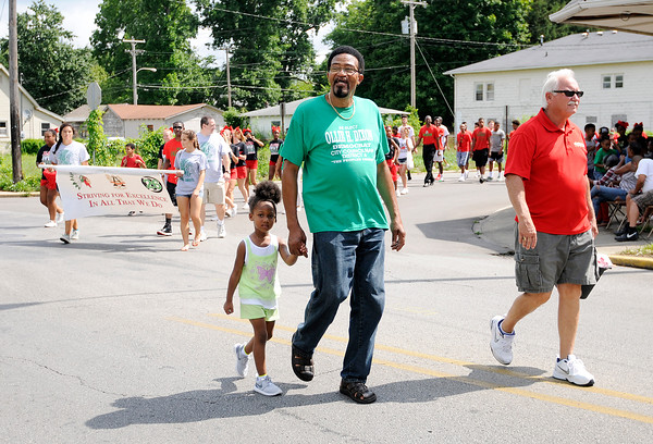 Don Knight | The Herald Bulletin<br /> Ollie Dixon and ACS Superintendent Terry Thompson lead Dixon's Back-to-School parade on Saturday.