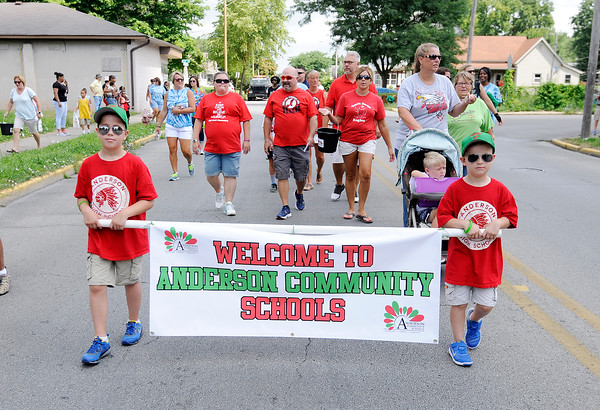 Don Knight | The Herald Bulletin<br /> Representatives from each of ACS' school buildings walked in the Ollie Dixon Back-to-School parade on Saturday.