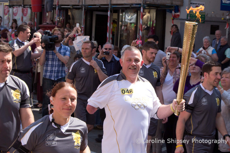 Torchbearer 048 Anthony Bird from Burnham on Sea carries the Olympic Flame in Wells on 22nd may 2012