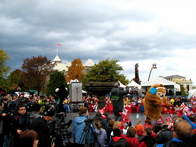 Yes, one of the mascots actually looks like a big fuzzy poop.