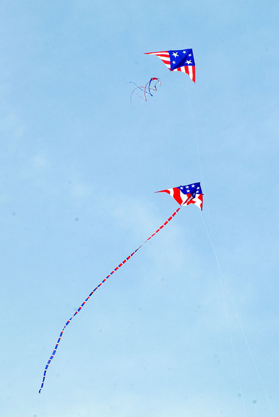 """<font size=""""3"""">These two smaller kites were in the air most of the day.</font>"""