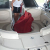 Karen taking the covers off our boat at our dock.