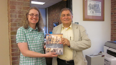 Cesare Muccari, director of Greensburg Hempfield Area Library and also representing the Westmoreland library system, presented Jennifer Gilley, head librarian at Penn State New Kensington, with a copy of the book for the campus' Elisabeth S. Blissell Library.