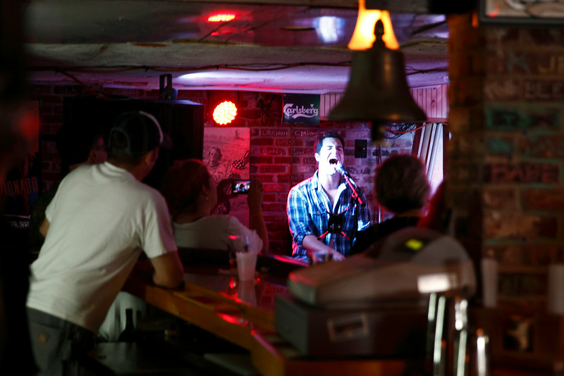 2014 July 27 Old Orchard Beach,ME-Alex Godriksen, keyboards and lead singer for Connecticut based Atlas Gray, performs at One Soho Square as part of the opening act for the Denny Laine, Peter Asher led Beatles/Wings tribute weekend.  Keith O'Leary, looks on from behind the bar.