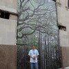 Doug Eng in front of one of his tree-scape facades.
