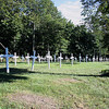 Record-Eagle/Loraine Anderson<br /> About 175 white crosses now mark possible unidentifed graves in the Onominese Indian Cemetery.