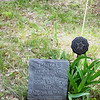 """Thomas Redbird's headstone is one of just a few at Onominese Indian Cemetery.<br /> He was born March 14, 1975 and died Aug. 1, 1900. """"He was singer in the M.E.C.""""<br /> (Methodist-Episcopal Church), it says."""