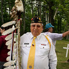 Record-Eagle/Loraine Anderson<br /> Alvin Pedwaydon carries an eagle staff honoring Susan Yanott Miller from the loving family and loving daughter Alvina Miller Anderson Marshall.  Each feather represents a veteran in the family.  Pedwaydon, an Eagletown post member, is the newly elected tribal chairman of the Grand Traverse Band of Ottawa and Chippewa Indians.