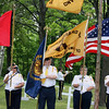 "Record-Eagle/Loraine Anderson<br /> An American Legion Eagletown Post 120 color guard stands at attention as adjutant Steve Alguires plays ""Taps"" during the Memorial Day service at Onominese Indian Cemetery Monday, May 28."