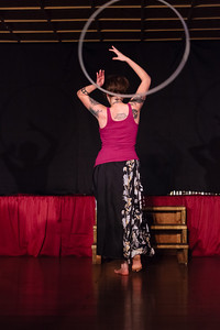 Miss Nora leaps and spins through her hoop