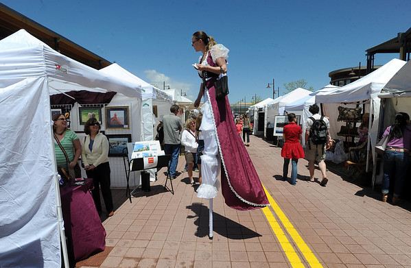 "Valerie Morris, left, of Frequent Flyers Dance Studio, walks between the booths on Sunday.<br /> The Twenty Ninth Street mall held the third annual Open Studios Spring Art Fair this weekend.<br /> For photos and a video of the fair, go to  <a href=""http://www.dailycamera.com"">http://www.dailycamera.com</a>.<br /> Cliff Grassmick / May 16, 2010"