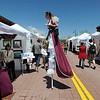 """Valerie Morris, left, of Frequent Flyers Dance Studio, walks between the booths on Sunday.<br /> The Twenty Ninth Street mall held the third annual Open Studios Spring Art Fair this weekend.<br /> For photos and a video of the fair, go to  <a href=""""http://www.dailycamera.com"""">http://www.dailycamera.com</a>.<br /> Cliff Grassmick / May 16, 2010"""