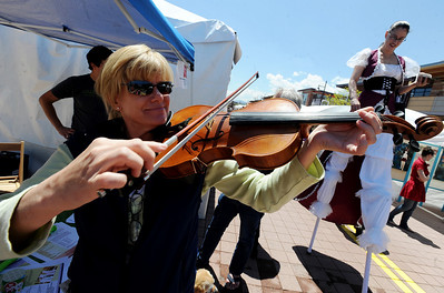 Ann Yeager tries out the viola at the Parlando School of the Arts booth. The Twenty Ninth Street mall held the third annual Open Studios Spring Art Fair this weekend. For photos and a video of the fair, go to www.dailycamera.com. Cliff Grassmick / May 16, 2010