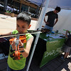 """Brian Ordones, 7, tries out the violin at the Parlando School of the Arts booth.<br /> The Twenty Ninth Street mall held the third annual Open Studios Spring Art Fair this weekend.<br /> For photos and a video of the fair, go to  <a href=""""http://www.dailycamera.com"""">http://www.dailycamera.com</a>.<br /> Cliff Grassmick / May 16, 2010"""