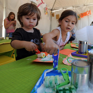 Hudson Fox, 2, and his sister, Ava, 4, paint at the Clementine Studios booth on Sunday. The Twenty Ninth Street mall held the third annual Open Studios Spring Art Fair this weekend. For photos and a video of the fair, go to www.dailycamera.com. Cliff Grassmick / May 16, 2010
