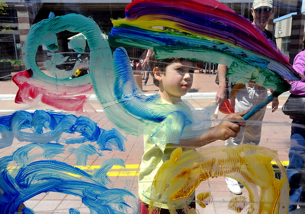 """Gabriel Salata, 5, paints a mural at the Clementine Studio booth on Sunday.<br /> The Twenty Ninth Street mall held the third annual Open Studios Spring Art Fair this weekend.<br /> For photos and a video of the fair, go to  <a href=""""http://www.dailycamera.com"""">http://www.dailycamera.com</a>.<br /> Cliff Grassmick / May 16, 2010"""