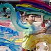 "Gabriel Salata, 5, paints a mural at the Clementine Studio booth on Sunday.<br /> The Twenty Ninth Street mall held the third annual Open Studios Spring Art Fair this weekend.<br /> For photos and a video of the fair, go to  <a href=""http://www.dailycamera.com"">http://www.dailycamera.com</a>.<br /> Cliff Grassmick / May 16, 2010"