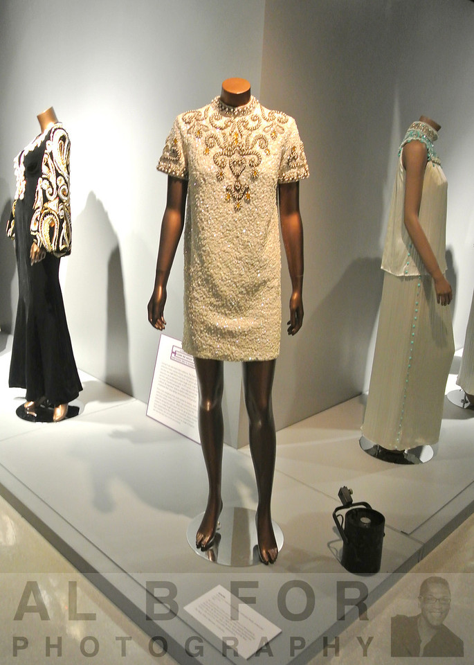 GOLDIE.  White wool seguined mini dress with glass beads, stones and gold trim.  1968