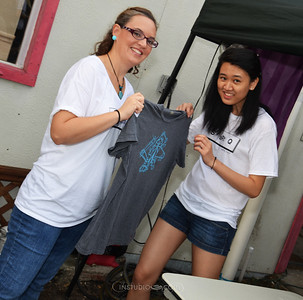 Volunteers Chrissy Schebilski & Ziyue Chen working the shirt drying station.