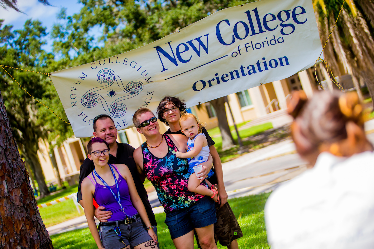 A family poses for photos during the first day of Orientation at New College.