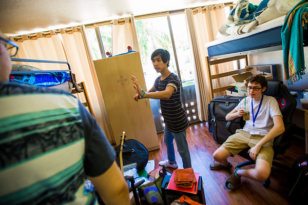 First-year students organize their dorm room during Orientation.