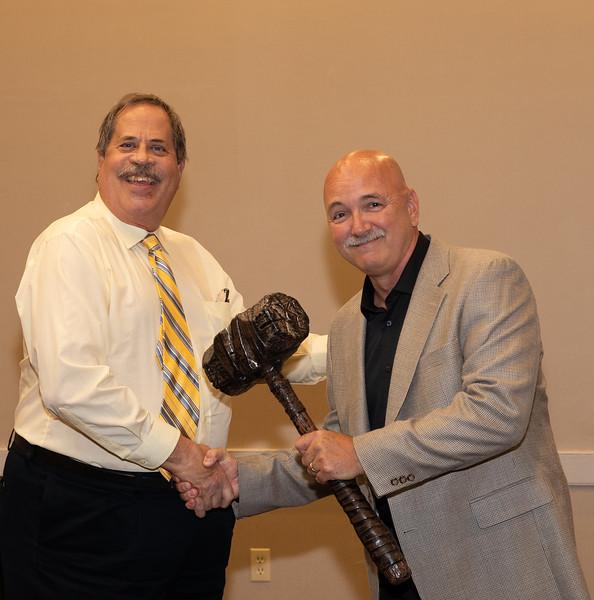 Ron Lawrence handing President's gavel to new President Matt Klinger