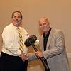 Ron Lawrence handing President's gavel to new President Matt Klinger
