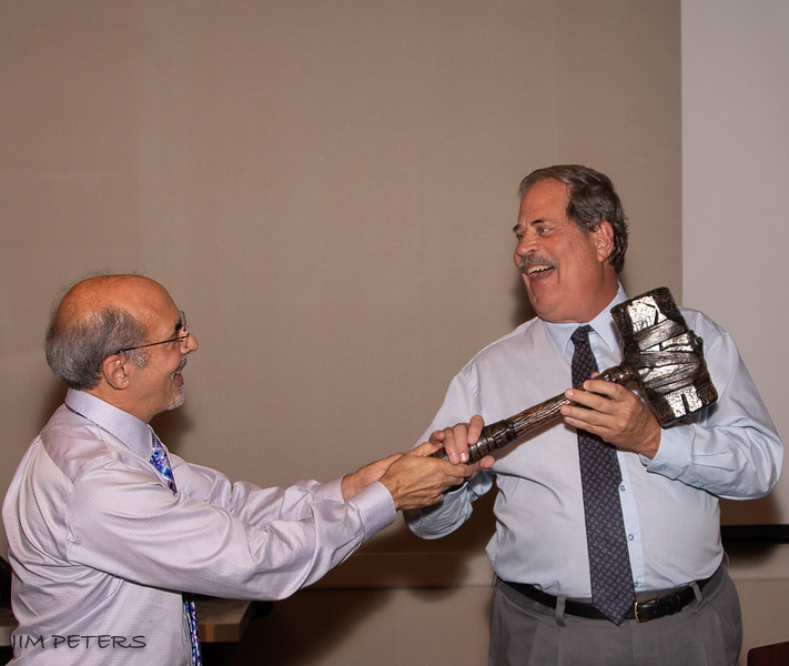 Outgoing President George passing gavel to Incoming President Ron Lawrence