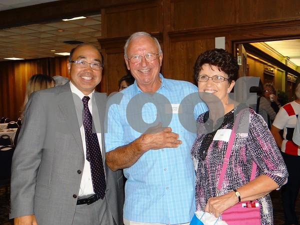 Emile Li, Tom Stumf, and Vicki Stumf.