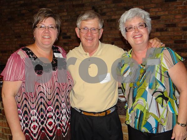 Michelle Garrett, Fred Larson, and Mary Dencklau.