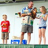 "Debbie Blank | The Herald-Tribune<br /> ""Is it a sloth?"" asked Amazon John (center). ""No!"" said the crowd. ""Is it a koala? Is it a kangaroo?"" Two more no answers. Then Grace Mause (right), 11, Milan, shouted the right animal name -- a kinkajou. With them is Jordan Green, 7, Osgood."