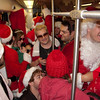 How many Santas fit inside one Metro train car? Many!