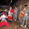 Santas joined the Mariachis in song and dance.