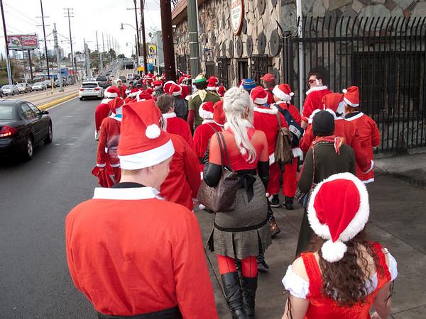 Santas making their way through East Los Angeles and our next destination: El Mercadito.