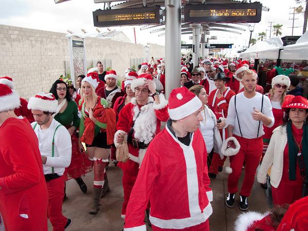 500 Santas throng the Metro station.